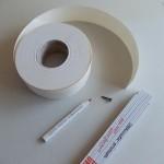 Rysujemy koło przy pomocy wkrętu, ołówka i taśmy papierowej do szpachlowania.